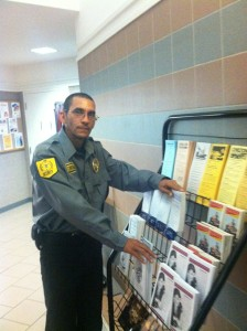 Officer Rojas takes a few minutes to pose for a photo while on duty