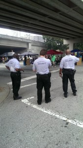 Officers looks on as the Sweet Auburn Music Festival begans
