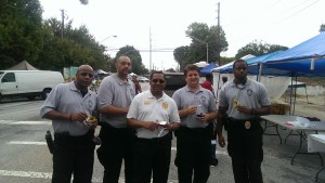 Officers along with President / CEO Ravenell (Center), prepares for the Atlanta Sweet Auburn Music Festival