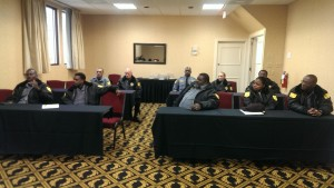 Officer Hickson (front left) explains a situation during in-service officer's training